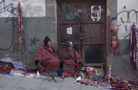 Vendors of traditional Aymara souvenirs in a street of La Paz, Bolivia, South America - 01.09.2013