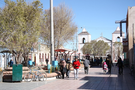 small town life: People on boulevard in a center of Uyuni, Bolivia, South America - 17.09.2013