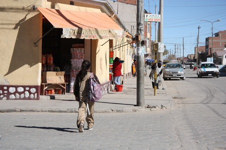 salar: People walk in a street of Uyuni. Uyuni is a small town near famous Salar de Uyuni Reserve, Potosi region, Bolivia, South America - 17.09.2013 Editorial