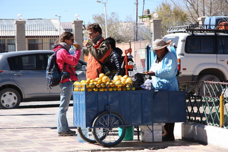 america countryside: Street seller of orange juice in Uyuni, Bolivia, South America - 17.09.2014