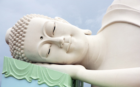 buddha head: The face of Sleeping Buddha in Vietnam Stock Photo