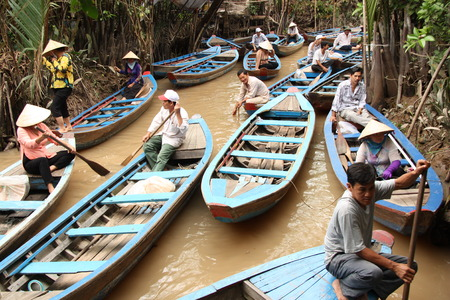 can tho: Vietnam people at the boats in Mekong Delta - 31.07.2014