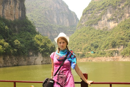 Young woman traveler at the tourist cruise boat at Three Gorges on Yangtze river, China photo