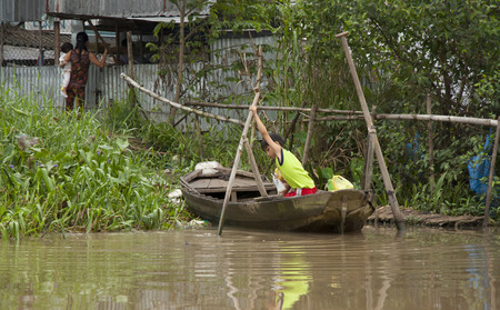 south east asia: Boy on a boat at Mekong River, Can Tho, Vietnam - 01.08.2014