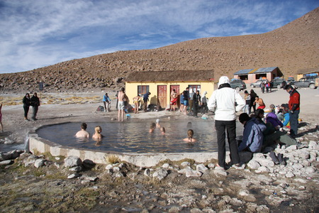 water spring: People at Geothermal hot water spring in Andes, Atacama desert in Uyuni, Bolivia - 19.09.2013