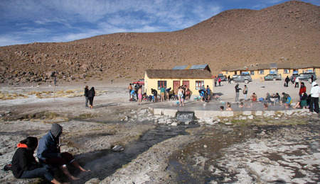 water spring: People rest at the geothermal hot water spring in Atacama desert in Uyuni, Bolivia, Andes - 19.09.2013 Editorial