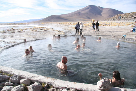 water spring: People rest at the geothermal hot water spring in  Atacama0 desert in Uyuni, Bolivia, Andes - 19.09.2013 Editorial