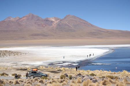 atacama: People in the lagoon in Atacama Desert in Uyuni, Bolivia, Andes - 18.09.2013 Editorial