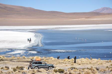 atacama: People at the mountain lake in Eduardo Avaroa National Park, Atacama Desert in Uyuni, Bolivia, Andes - 18.09.2013