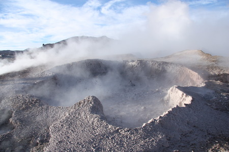 Geyser with mud and vapor above in the natural reserve Reserva de Fauna Andina Eduardo Avaroa in Bolivia photo