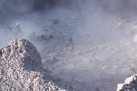 Geyser with boiling mud in the natural reserve Reserva de Fauna Andina Eduardo Avaroa in Bolivia