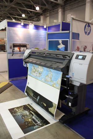 large: Large Format Digital Printer - Hewlett-Packard. Hewlett-Packard stand on the exhibition Photoforum-expo 2010, Moscow, Russia. April 16th, 2010