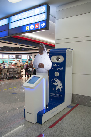 store sign: Information stand with hologram assistant in the waiting lounge of Dubai Airport terminal United Arab Emirates 28.07.2014