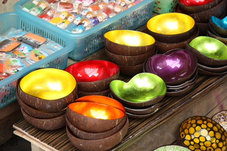 souvenir traditional: Vietnamese traditional bowls made from a coconut and sea shells and magnet souvenirs