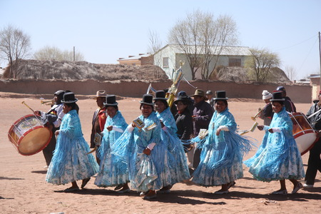 andean: People dance during the holiday in a small village square in Bolivian Altiplano Andes South America 21.09.2013