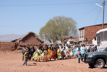 small country town: People dance at the festival in Andes Bolivia Altiplano South America 21.09.2013