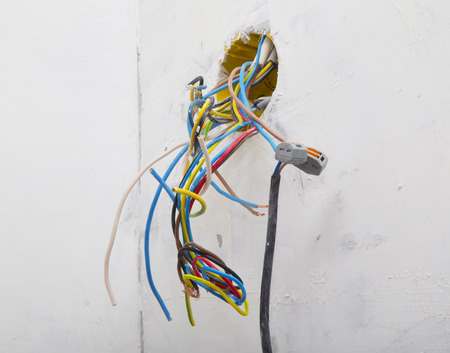 new construction: Wires connected with electrical cable during residential renovation Stock Photo