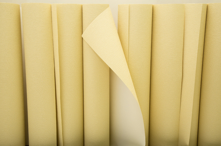reconstruct: Yellow wallpapers in a row ready for applying on the wall Stock Photo