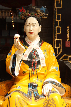 Famous woman emperor of China Cisi is eating dumpling