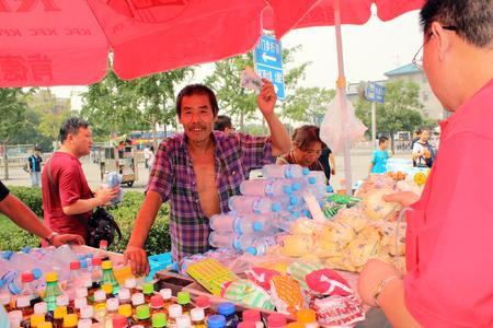 bargaining: CHINA, BEIJING, 7 JULY 2010 - Street vendor is bargaining in Beijing