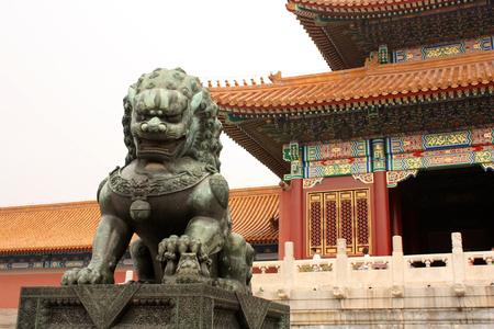 guarding: Bronze lion is guarding Forbidden City in Beijing, China Stock Photo