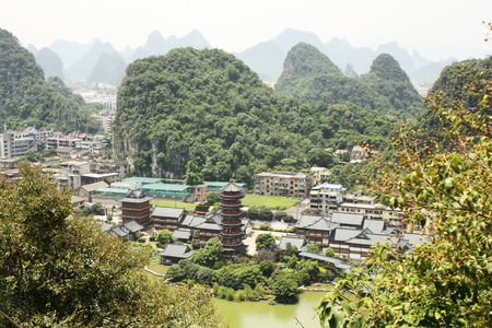 mist: The landscape of Guilin City with Mulong Pagoda and Lake in Guangxi, China Stock Photo