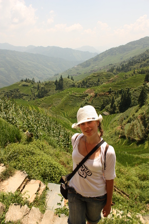Young girl tourist travelling in a village near Guilin, Rice Field Terrace, China photo