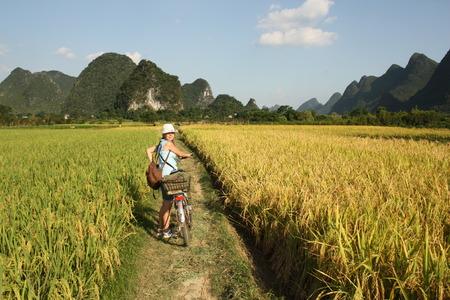 Cycling in China countryside, rice fields of Yangshou photo