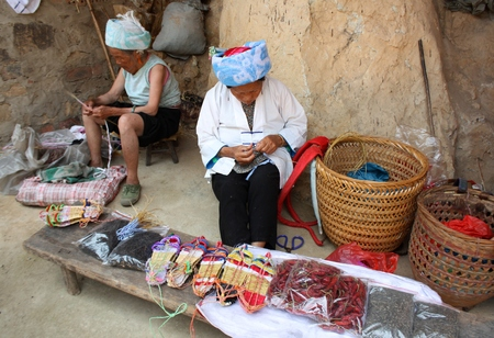stitchwork: CHINA, PINJAN, 5 AUGUST 2010 - Chinese women making traditional straw shoes, China
