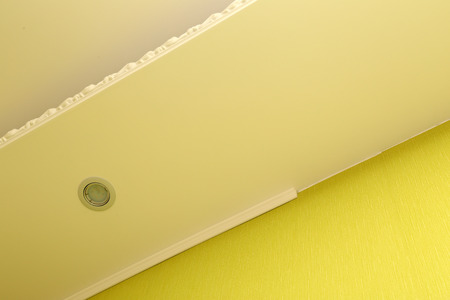 ceiling: Installing white plastic molding to decorate ceiling and wall