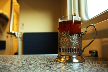 Traditional train cup with hot tea in a sleeper train wagon, Russia