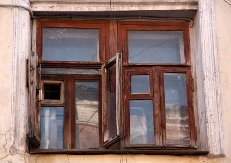 indigence: Old house with an antique wooden window