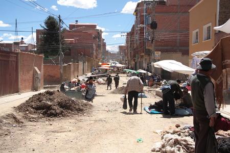 poorness: BOLIVIA, LA PAZ, EL ALTO, 1 SEPTEMBER 2013 - Poverty in a street of El Alto, La Paz, Bolivia, South America Editorial