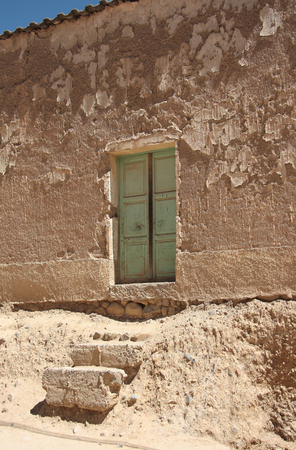 barrenness: The door and steps of an old dilapidated house in Bolivia, El Alto, La Paz, Altiplano Stock Photo