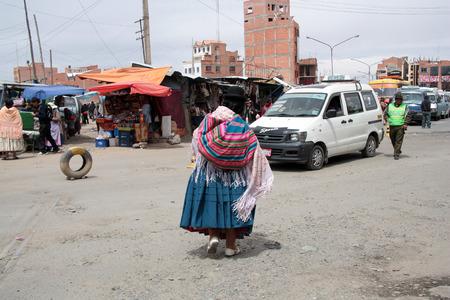 hard sell: BOLIVIA, LA PAZ, EL ALTO, AUGUST 28, 2013 - People at Ceja transport district in El Alto, La Paz, Bolivia, South America