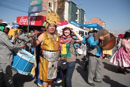 cochabamba: BOLIVIA, COCHABAMBA, 15 AUGUST 2013 - Inca man in traditional Inca costume with a happy tourist girl at Cochabamba parade in Bolivia