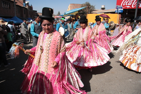 cochabamba: BOLIVIA, COCHABAMBA, 15 AUGUST 2013 - People dance and play music in traditional costumes at parade in Cochabamba, Bolivia