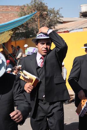 cochabamba: BOLIVIA, COCHABAMBA, 15 AUGUST 2013 - Men dancers with musical rattles at carnival in Cochabamba, Bolivia