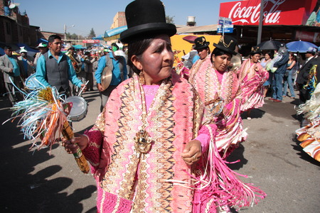 cochabamba: BOLIVIA, COCHABAMBA, 15 AUGUST 2013 - People dance and play music in traditional costumes at carnival in Cochabamba, Bolivia