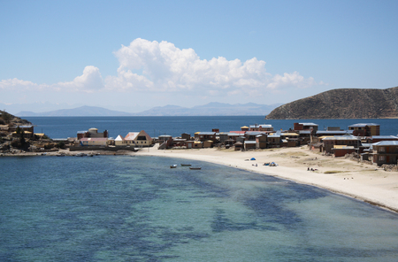 lake beach: Beautiful foreland with a beach at the Isla Del Sol at Titicaca lake in Bolivia Stock Photo