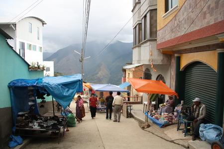 poorness: BOLIVIA, COROICO, 15 SEPTEMBER 2013 - Street Market in Coroico town, Yungas region, Bolivia, South America Editorial