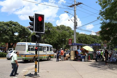 BOLIVIA, SANTA CRUZ DE LA SIERRA, 26 JANUARY 2017 - People waiting for bus in a street of Santa Cruz, Bolivia Editorial