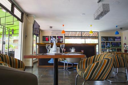 BOLIVIA, SANTA CRUZ, LAS PALMAS HOTEL, 18 JANUARY 2017 - Interior of modern restaurant with served tables ready for lunch