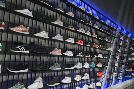 RUSSIA, MOSCOW, 23 MAY 2017 - Interior of Adidas sports boutique outlet with sport shoes on shelves