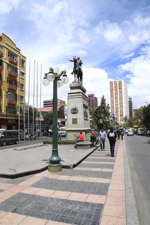 BOLIVIA, LA PAZ, 13 FEBRUARY 2017 - Sidewalk in El Prado walking street with Simon Bolivar statue in a center of La Paz, Bolivia.