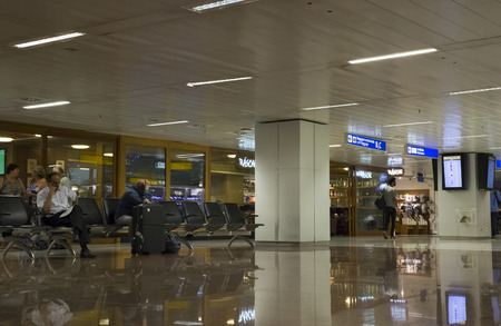 BRAZIL, SAO PAULO, 20 FEBRUARY 2017 - People rest in the waiting lounge of Guarulhos International Airport, GRU, Sao Paulo, Brazil