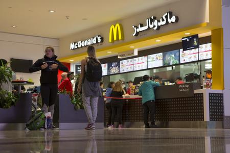 UNITED ARAB EMIRATES, DUBAI, 20 FEBRUARY 2017 - People at McDonalds restaurant in Dubai International Airport