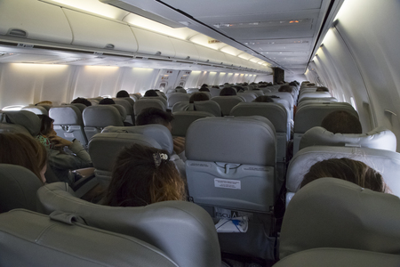 BOLIVIA, LA PAZ, 19 FEBRUARY 2017 - Economy class airplane cabin with passengers of Bolivian Airlines Redakční