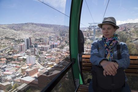 Young woman in La Paz Teleferico Cable car, Bolivia