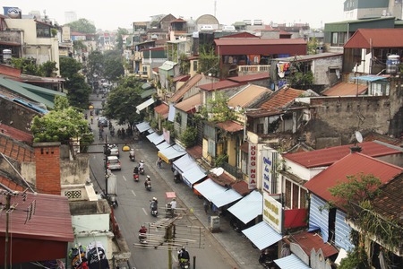 VIETNAM, HANOI, 8 AUGUST 2014 - Morning view of the foggy street with motorbikes in the old part of Hanoi